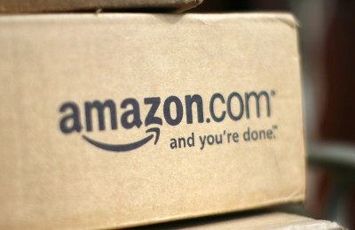 A box from Amazon.com is pictured on the porch of a house in Golden, Colorado in this July 23, 2008 file photo.  Amazon.com Inc's quarterly earnings beat Wall Street's most bullish expectations as the world's largest Internet retailer brought costs under control, sending its shares up almost 15 percent. REUTERS/Rick Wilking/Files  (UNITED STATES - Tags: BUSINESS)