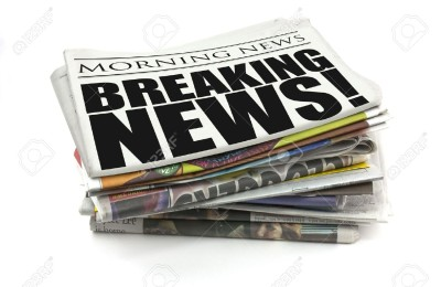 5565913-breaking-news-headline-on-a-mock-up-newspaper-Stock-Photo